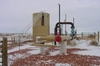Pig receiver and 400-bbl steel water tank located at the pipeline tie-in point.