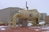60-inch X 20-ft inlet separator with the compressor buildings in the background.